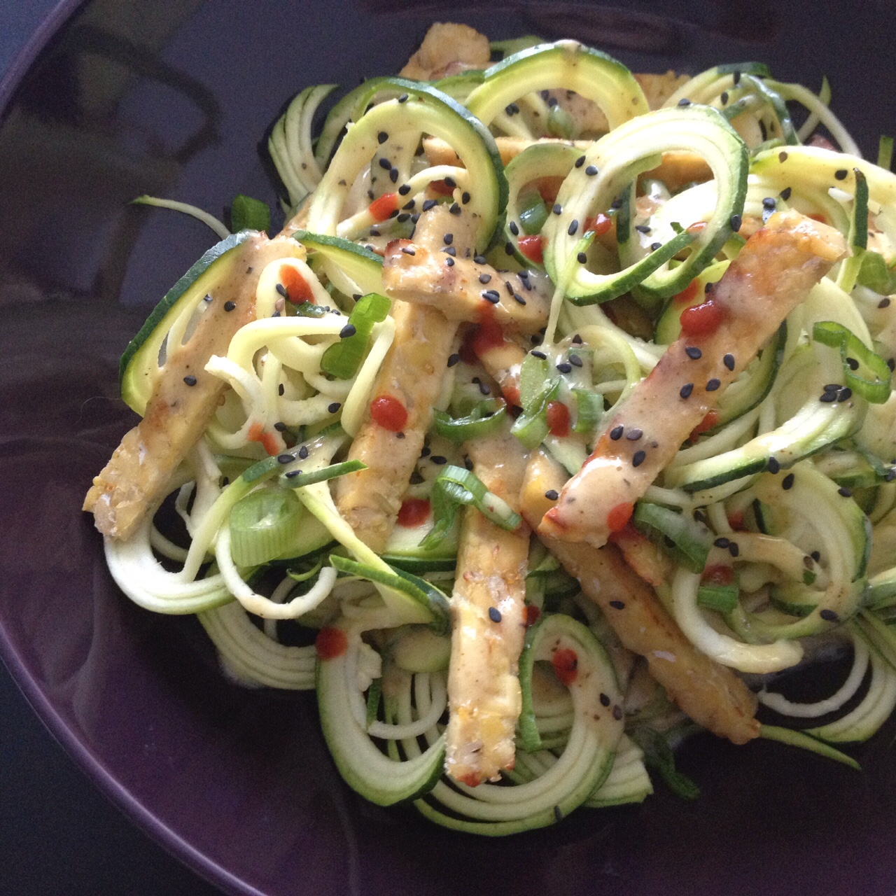 Zucchini noodles with tempeh and lemon tahini dressing